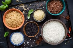 Different types of rice on bowls royalty free stock image