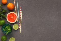 Variety of ripe citruses on gray background, top view royalty free stock photo