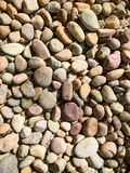 Variety of rocks on the ground Royalty Free Stock Photos