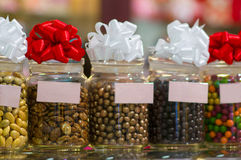 Variety of round candies in jars on in shop Stock Images
