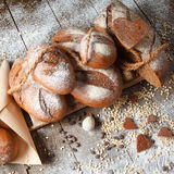Variety of rye bread on a wooden background. With flour, grain and quail eggs Stock Image