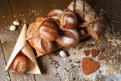Variety of rye bread on a wooden background. With flour, grain and quail eggs Royalty Free Stock Photos