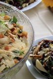 Variety of salads on table at party Stock Photo
