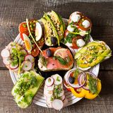 Sandwiches or tapas with bread , cream cheese, vegetable and tasty toppings. Healthy food for lunch or breakfast. Flat lay royalty free stock photos