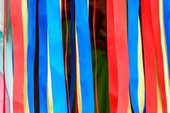 Variety of satin ribbons in different colors and lengths stock photos