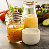 Variety of sauces and salad dressings. Variety of homemade sauces and salad dressings in jars including vinaigrette, ranch and honey mustard royalty free stock photos