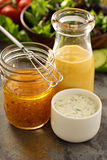 Variety of sauces and salad dressings. Variety of homemade sauces and salad dressings in jars including vinaigrette, ranch and honey mustard royalty free stock image