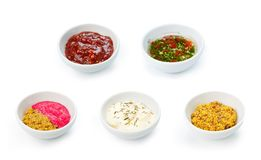 Variety of sauces in white bowls Stock Photos