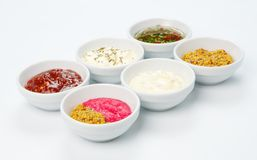 Variety of sauces in white bowls Stock Images