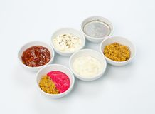 Variety of sauces in white bowls Royalty Free Stock Image