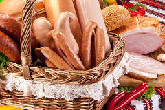 Variety of sausage products in basket. Royalty Free Stock Photography