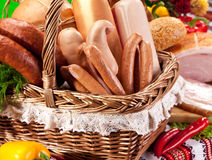 Variety of sausage products in the basket. Stock Photo
