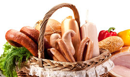 Variety of sausage products in basket. Close-up shot. Clipping path stock images