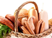 Variety of sausage products in basket. Stock Photos