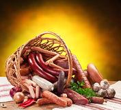 Variety of sausage products in the basket. Royalty Free Stock Photography