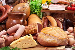 Variety of sausage products, cheese, eggs and vegetables. Royalty Free Stock Image