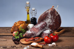 Variety of sausage products with vegetables Stock Photos