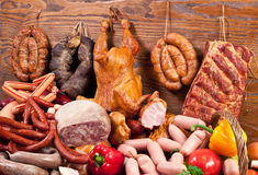 Variety of sausage products and vegetables. Stock Photo