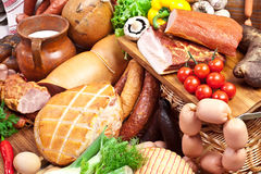 Variety of sausage products with vegetables. Stock Images