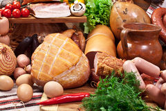 Variety of sausage products with vegetables and herbs. Royalty Free Stock Photography