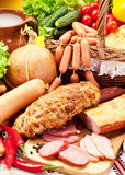 Variety of sausages with vegetables. Royalty Free Stock Image