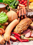 Variety of sausages with vegetables and milk products. Stock Image
