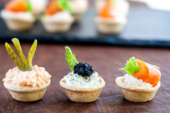Variety of savory mini pastry tartlets. Stock Photo