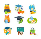 Variety of school lunches, next to backpacks, books, school stationery.
