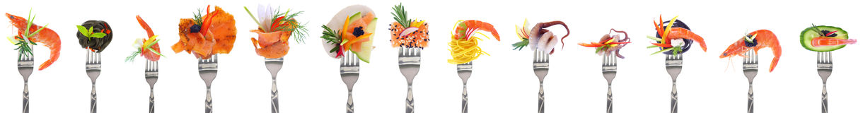 Variety of seafood starters - white background. Variety of seafood appetizers on forks - white background Royalty Free Stock Image
