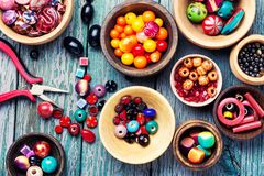 Colorful beads in wooden bowls. Variety of shapes and colors beads to make a bead necklace.Handcraft Royalty Free Stock Photography