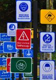 Variety of sign labels near the street in big city for warning drive drive carefully in Songkran festival in Thailand. Warning city big songkran Thailand Royalty Free Stock Photos
