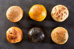 Variety of Six Bread Rolls Arranged in Two Rows stock photography