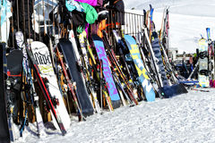 Variety of skies and snowboards standing outside a mountain bar Stock Image