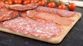 Variety of sliced italian salami. On wooden board stock video