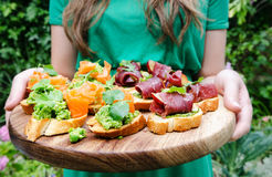 Variety of small canapes before the party Stock Image