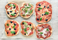 Variety of small pizzas Stock Image