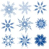 Variety of Snowflakes Clip Art. A clip art illustration of a variety of 9 snowflakes in blue isolated on white Stock Photography