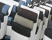 Variety of socks on stands in mall Royalty Free Stock Photo