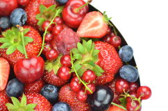 Variety of soft fruits, strawberries, raspberries, cherries, blueberries, currants. Isolated on white Stock Photography