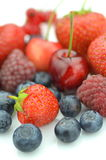 Variety of soft fruits, strawberries, raspberries, cherries, blueberries, currants. Isolated on white Royalty Free Stock Photography