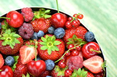 Variety of soft fruits, strawberries, raspberries, cherries, blueberries, currants. On table Royalty Free Stock Images