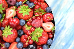 Variety of soft fruits, strawberries, raspberries, cherries, blueberries, currants. On table Royalty Free Stock Image