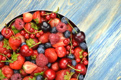 Variety of soft fruits, strawberries, raspberries, cherries, blueberries, currants. On table Stock Photo