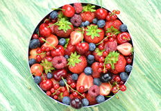 Variety of soft fruits, strawberries, raspberries, cherries, blueberries, currants. On table Stock Photography