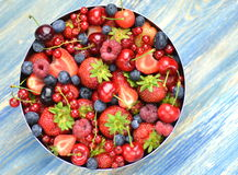 Variety of soft fruits, strawberries, raspberries, cherries, blueberries, currants. On table Stock Photos