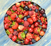 Variety of soft fruits, strawberries, raspberries, cherries, blueberries, currants. On table Royalty Free Stock Photography