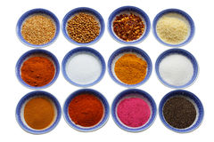 Variety of spices. Variety of colorful spices in nine bowls Royalty Free Stock Photography