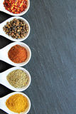 Variety of spices on a black slice Royalty Free Stock Photo