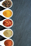 Variety of spices on the black slice Royalty Free Stock Images