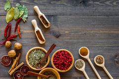 Variety of spices and dry herbs in bowls on wooden kitchen table background top view mock-up Stock Images